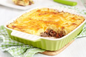 Cottage pie in green baking dish