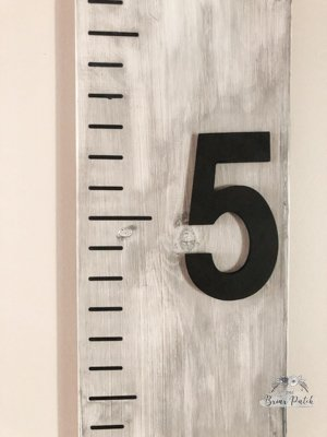 Close up front view of 3D chipboard numbers on finished Wooden Growth Chart Ruler