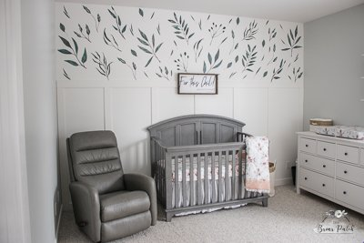 Full view of the classic white board and batten with urban walls wall decals in a baby nursery